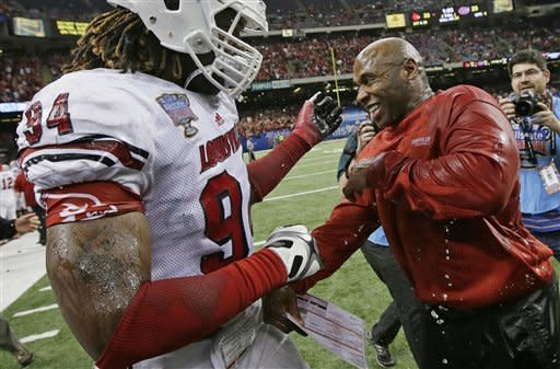 Louisville head coach Charlie Strong reacts with defensive end Lorenzo Mauldin (94) after a 33-23 win over Florida in the Sugar Bowl NCAA college football game Wednesday, Jan. 2, 2013, in New Orleans. (AP Photo/Dave Martin)