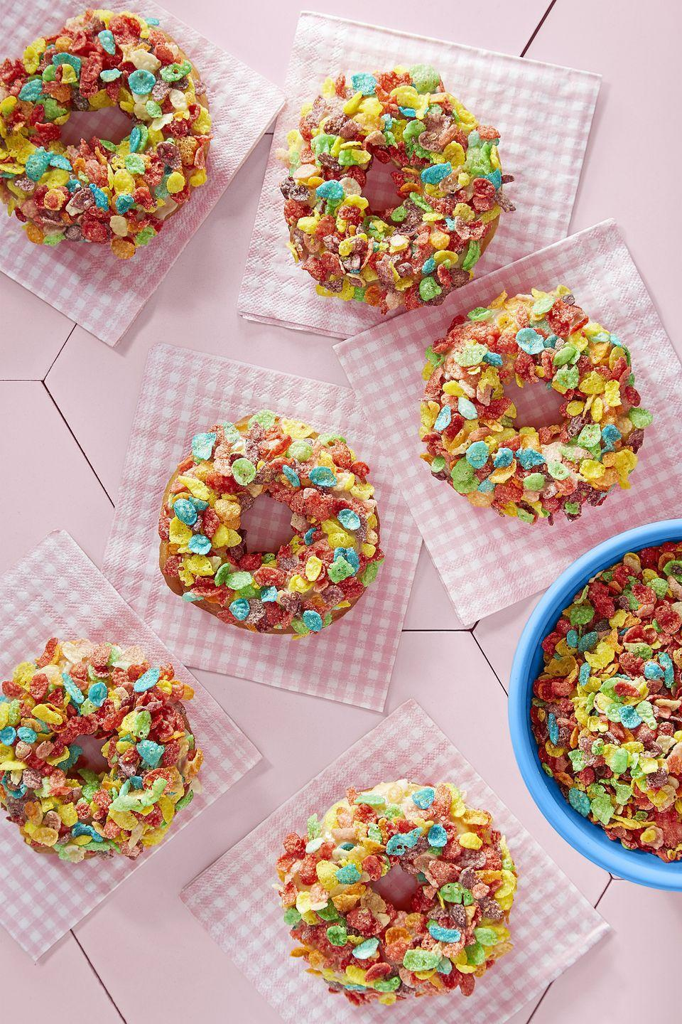 """<p>You'll feel like a kid again indulging in these cereal-topped donuts. </p><p><strong><a href=""""https://www.countryliving.com/food-drinks/recipes/a46352/fruity-pebbles-doughnuts-recipe/"""" rel=""""nofollow noopener"""" target=""""_blank"""" data-ylk=""""slk:Get the recipe"""" class=""""link rapid-noclick-resp"""">Get the recipe</a>.</strong></p>"""