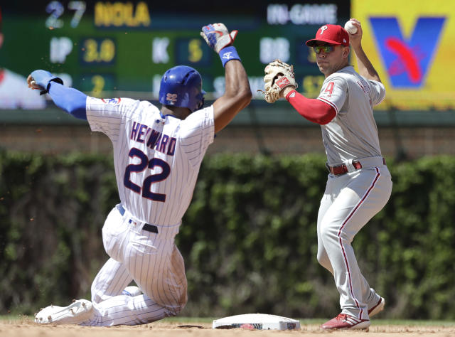 Philadelphia Phillies second baseman Scott Kingery, right, throws out Chicago Cubs' Albert Almora Jr., at first after forcing out Jason Heyward at second during the fourth inning of a baseball game Thursday, May 23, 2019, in Chicago. (AP Photo/Nam Y. Huh)