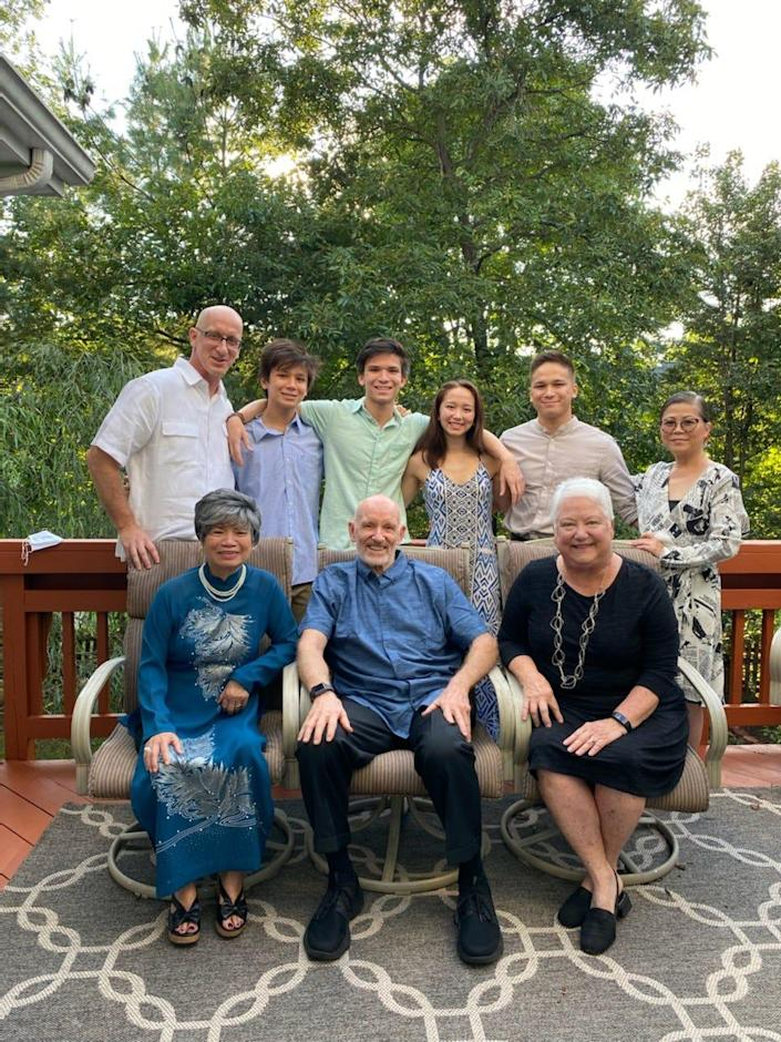 Thuan Le Elston, right, with her husband, their four children, and her mother and parents-in-law in September 2021 in Northern Virginia.