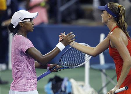 Victoria Duval of the U.S. shakes hands after losing to Daniela Hantuchova of Slovakia at the U.S. Open tennis championships in New York