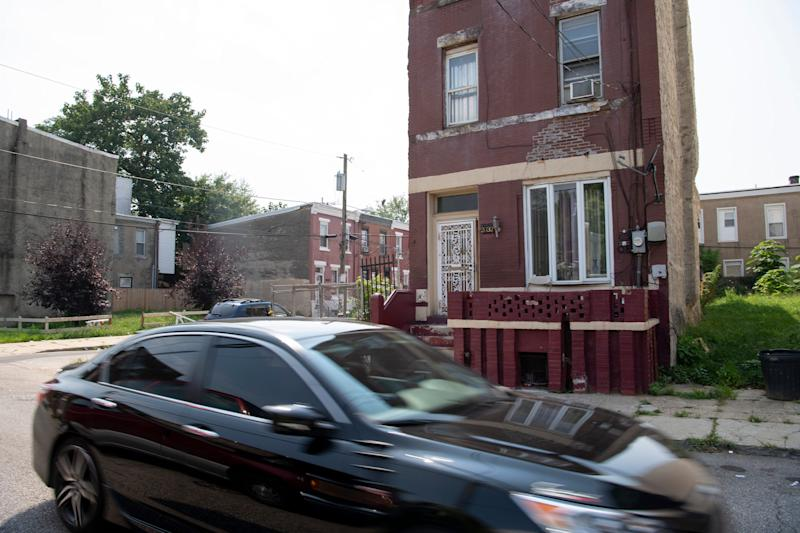 A car passes by the home of Leroy Roebuck in North Philadelphia.