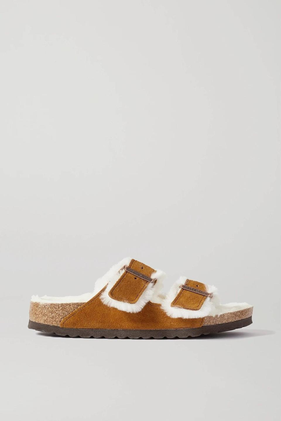 <p>Slippers are a must during the cold season, and while there are many iterations, we're currently crushing on these <span>Shearling-Lined Birkenstocks</span> ($150). Worn with thick socks, they will feel like a literal hug for her feet, and she'll never be happier than when she's wearing them around the house.</p>