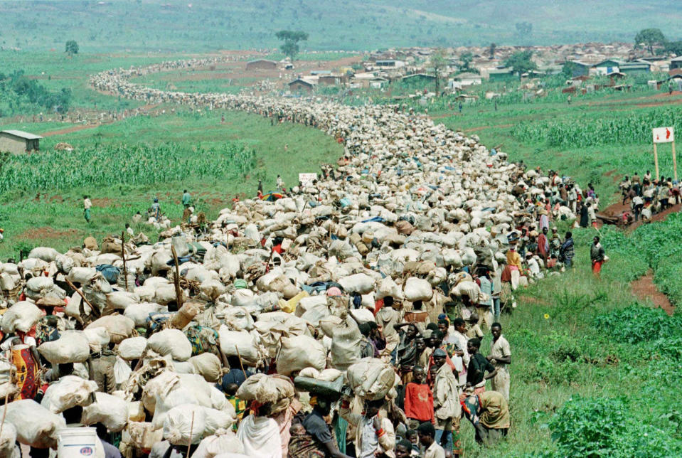 """FILE - In this Thursday, Dec. 19, 1996 file photo, tens of thousands of Rwandan refugees, who have been forced by the Tanzanian authorities to return to their country despite fears they will be killed upon their return, stream back towards the Rwandan border on a road in Tanzania. France's role before and during 1994's Rwandan genocide was a """"monumental failure"""" that the country must face, the lead author of a sweeping report commissioned by President Emmanuel Macron said, as the country is about to open its archives from this period for the first time to the broader public. (AP Photo/Jean-Marc Bouju, File)"""