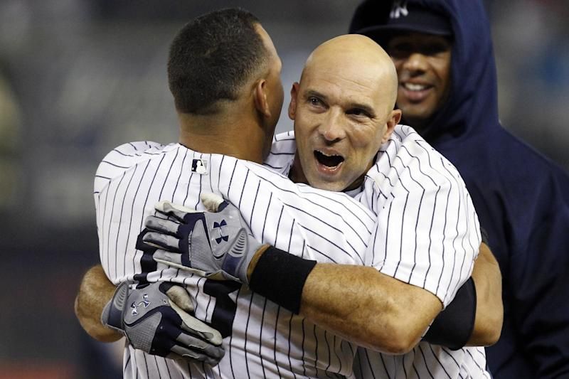 New York Yankees' Alex Rodriguez, left, embraces Raul Ibanez after Ibanez hit a 12th inning, walk-off RBI single to give the Yankees a 4-3 win in their baseball game against the Boston Red Sox at Yankee Stadium in New York, Tuesday, Oct. 2, 2012. (AP Photo/Kathy Willens)