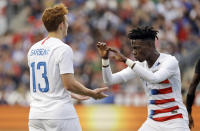 FILE - In this May 28, 2018, file photo, United States' Josh Sargent, left, and Tim Weah celebrate during an international friendly soccer match against Bolivia in Chester, Pa. Weah was included on the U.S. roster for the FIFA Under-20 World Cup on Friday, May 10, 2019, but Sargent was not, making it likely he will be with the senior national team at the CONCACAF Gold Cup this summer. (AP Photo/Matt Slocum, File)
