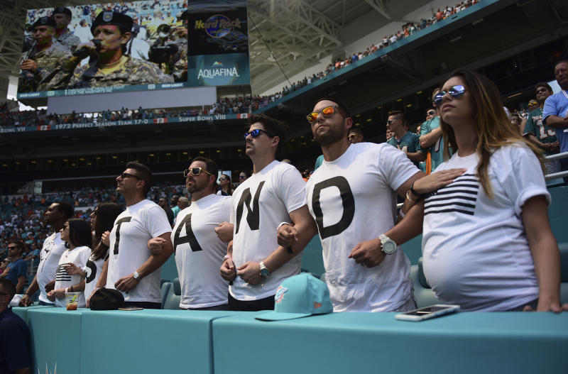 Fans at the Dolphins-Titans game in Miami have an idea what players should do during the playing of the national anthem. (AP)