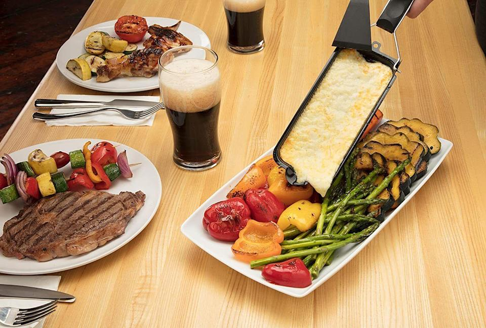 """It can add some gooey goodness to your leftovers and we guarantee they will taste amazing!<br /><br /><strong>Get it from Amazon for <a href=""""https://www.amazon.com/Cuisinart-CCMP-203-Cheese-Melt-Black/dp/B07CBYP2LC?&linkCode=ll1&tag=huffpost-bfsyndication-20&linkId=b11ccdcede1cc97c49cdf1c9556b26fe&language=en_US&ref_=as_li_ss_tl"""" target=""""_blank"""" rel=""""noopener noreferrer"""">$9.99</a>.</strong>"""