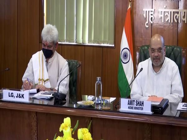 Home Minister Amit Shah (left) and Jammu and Kashmir Lieutenant Governor Manoj Sinha (right)