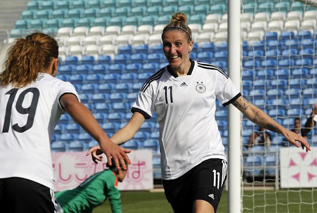 Germany's Anja Mittag, right, celebrates with teammate Fatmire Alushi after scoring their side's second goal during the women's soccer Algarve Cup final match between Germany and Japan at the Algarve stadium, outside Faro, southern Portugal, Wednesday, March 12, 2014. (AP Photo/Francisco Seco)