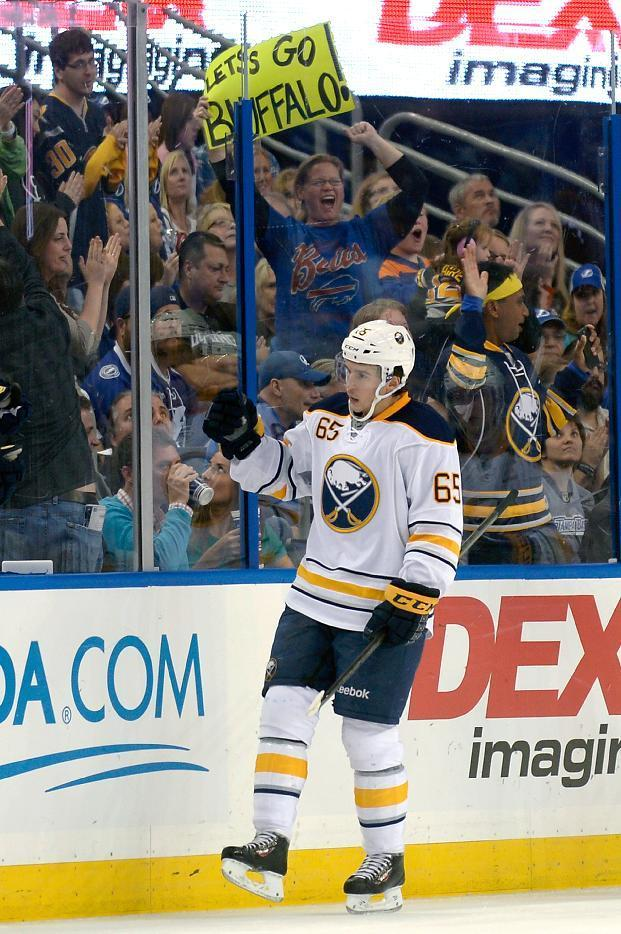 Buffalo Sabres right wing Brian Flynn (65) celebrates after scoring during the second period of an NHL hockey game against the Tampa Bay Lightning in Tampa, Fla., Saturday, Oct. 26, 2013. (AP Photo/Phelan M. Ebenhack)