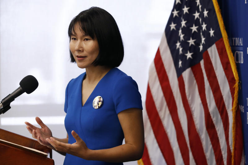 Hua Qu, the wife of Xiyue Wang, a Princeton University graduate student being held at an Iranian prison, speaks at a news conference to mark the third anniversary of her husband's imprisonment, Thursday, Aug. 8, 2019, at the National Press Club in Washington. (AP Photo/Patrick Semansky)