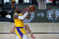 Los Angeles Lakers' LeBron James shoots against the Toronto Raptors during the first half of an NBA basketball game Saturday, Aug. 1, 2020, in Lake Buena Vista, Fla. (AP Photo/Ashley Landis, Pool)