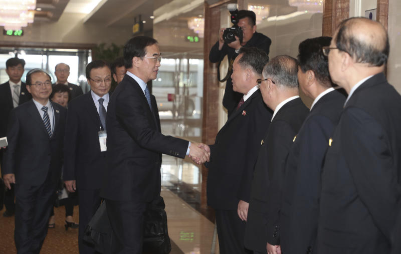 South Korean Unification Minister Cho Myoung-gyon, center left, shakes hands with Ri Son Gwon, chairman of the North Korean agency that handles inter-Korean affairs, at the Pyongyang Airport in Pyongyang, North Korea, Thursday, Oct. 4, 2018. A South Korean government delegation arrived in North Korea on Thursday for a joint celebration of the anniversary of a 2007 summit and to possibly hold further peace talks. (Joint Press Corps Pyeongyang Pool via AP)