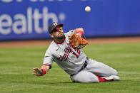 Washington Nationals left fielder Kyle Schwarber makes a sliding catch during the fourth inning of a baseball game against the New York Mets at Citi Field, Sunday, April 25, 2021, in New York. (AP Photo/Seth Wenig)