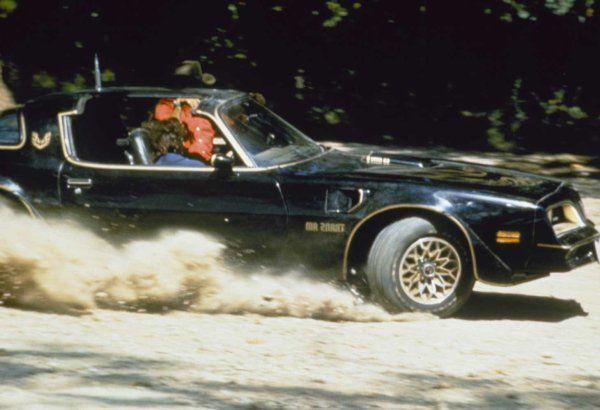 "<p>When <em>Smokey and the Bandit</em> director Hal Needham chose a 1977 Pontiac Trans Am to star in his movie alongside Burt Reynolds and Sally Field, he couldn't have predicted the impact that car would have on America.</p><p>The Trans Am actually looked more or less the same for more than a half decade before the film debuted. But that didn't matter. When audiences saw that Trans Am slide around corners, leap over broken bridges, and evade Sheriff Buford T. Justice (Jackie Gleason) for hundreds of miles, they wanted a black and gold T/A in their garage. After the movie debuted, sales leapt by about 30,000 cars from 1977 to 1978 and by another 24,000 for 1979. Americans went nuts for the Starlight Black Special Edition paint job, the T-Top roof, and the fact that the car was quicker and better-handling than the Corvette of the same generation. It was probably a combination of all three—plus a heaping dollop of Burt's star appeal—that made the Trans Am a legend.</p><p><a class=""link rapid-noclick-resp"" href=""https://www.amazon.com/gp/video/detail/0JC7Q6C9KTZYYRYJSQXRQXFPI5/?tag=syn-yahoo-20&ascsubtag=%5Bartid%7C10054.g.27421711%5Bsrc%7Cyahoo-us"" rel=""nofollow noopener"" target=""_blank"" data-ylk=""slk:AMAZON"">AMAZON</a></p>"