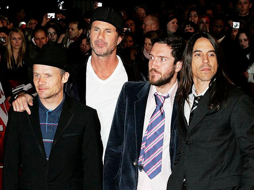 John Frusciante (second from right) stands alongside Red Hot Chili Peppers bandmates Flea, Chad Smith and Anthony Kiedis at the 2007 Brit Awards (Gareth Cattermole/Getty Images)