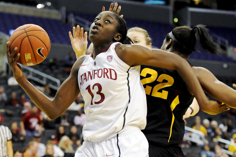 FILE - In this March 9, 2012, file photo, Stanford forward Chiney Ogwumike (13) pivots around Arizona State forward Janae Fulcher (22) during the second half of the NCAA college semifinals Pac-12 Conference tournament basketball game in Los Angeles. Ogwumike received 23 votes from a national media panel Tuesday, Oct. 30, to join The Associated Press' women's basketball preseason All-America team. (AP Photo/Gus Ruelas, File)