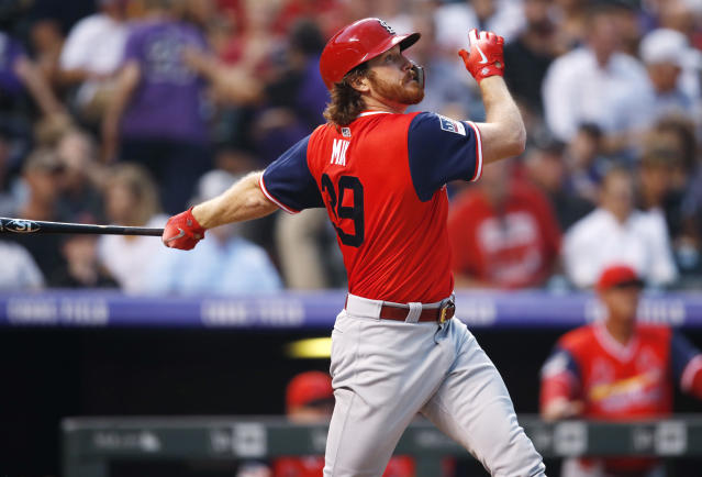 St. Louis Cardinals' Miles Mikolas follows the flight of his two-run home run off Colorado Rockies starting pitcher Antonio Senzatela in the second inning of a baseball game Friday, Aug. 24, 2018, in Denver. (AP Photo/David Zalubowski)