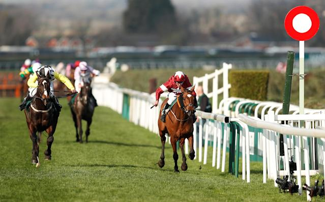 Horse Racing - Grand National Festival - Aintree Racecourse, Liverpool, Britain - April 14, 2018 Tiger Roll ridden by Davy Russell (R) crosses the line as he wins the 17:15 Randox Health Grand National Handicap Chase ahead of Pleasant Company ridden by David Mullins Action Images via Reuters/Matthew Childs