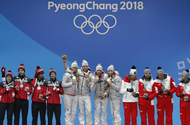 Medals Ceremony - Luge - Pyeongchang 2018 Winter Olympic Games - Team Relay - Medals Plaza - Pyeongchang, South Korea - February 16, 2018 - Gold medalists Natalie Geisenberger, Johannes Ludwig, Tobias Wendl and Tobias Arlt of Germany, silver medalists Alex Gough, Sam Edney, Tristan Walker and Justin Snith of Canada, bronze medalists Madeleine Egle, David Gleirscher, Peter Penz and Georg Fischler of Austria on the podium. REUTERS/Eric Gaillard