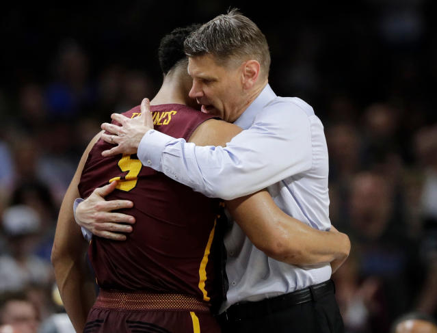 Porter Moser is staying in the Windy City. (AP Photo/David J. Phillip)