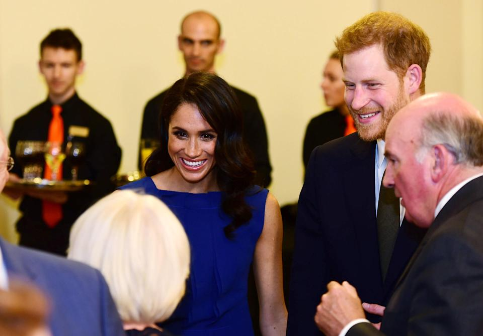 The Duke and Duchess of Sussex meet guests during the interval at the '100 Days to Peace'. (PA)