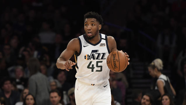 Utah Jazz guard Donovan Mitchell (45) dribbles the ball during the second half of an NBA basketball game against the New York Knicks in New York, Wednesday, March 4, 2020. (AP Photo/Sarah Stier)