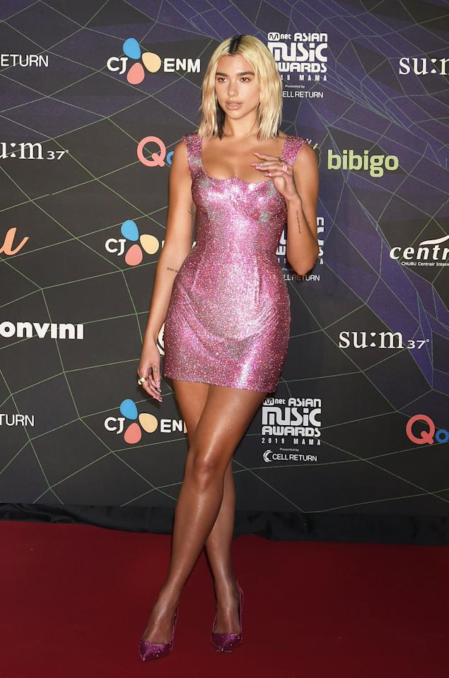 <p>Wearing a sparkly Versace minidress. </p>