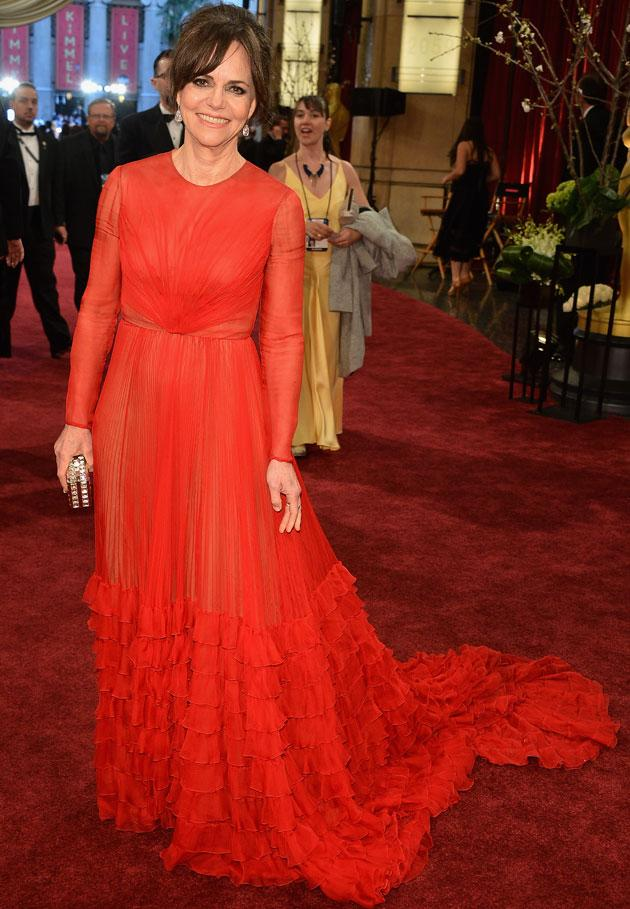 Lincoln star Sally Field looked elegant in a long-sleeved red chiffon number. Copyright [Getty]