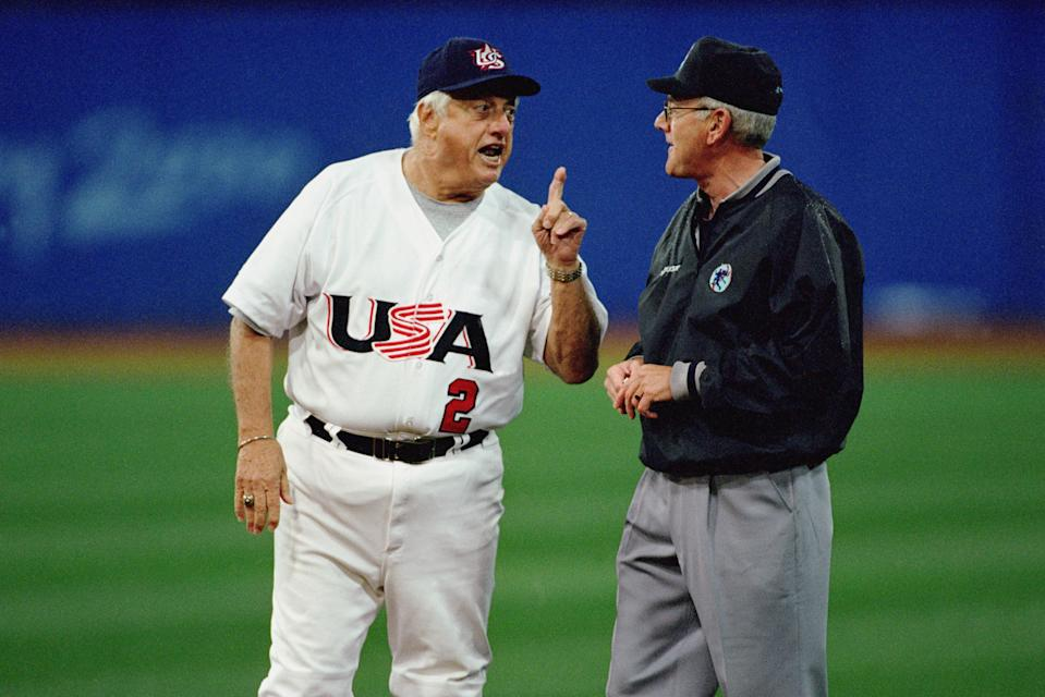 Team manager Tommy Lasorda of the USA talks to an official during the semifinal match against the USA at the Baseball Stadium in Olympic Park during the Sydney Olympic Games in Sydney, Australia on September 26, 2000. The USA defeated Korea 3-2 on a game winning home run at the bottom of the ninth, advancing them to the gold medal game. (Photo by Jamie Squire /Getty Images)
