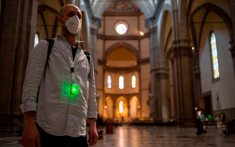 The small device, distributed free of charge at the beginning of a visit and returned at the end to be sanitized, signals with a sound, vibration and light when the minimum allowed distance between visitors is being exceeded - FLORENCE MUSEUM PRESS OFFICE/AFP via Getty Images