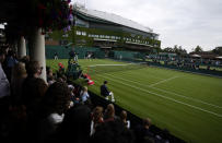 Czech Republic's Tereza Martincova serves to Alison Riske of the US during the women's singles first round match on day two of the Wimbledon Tennis Championships in London, Tuesday June 29, 2021. (AP Photo/Alastair Grant)