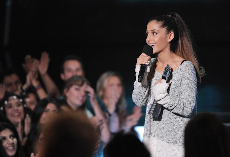 "FILE - In this May 1, 2014 file photo, Ariana Grande speaks at the iHeartRadio Music Awards at the Shrine Auditorium, in Los Angeles. Grande is having a breakthrough in music with the multiplatinum hit ""Problem,"" which is spending its 13th week in the top 10 on the Billboard Hot 100 chart. The song features rapper Iggy Azalea and is from Grande's sophomore album, ""My Everything,"" to be released Aug. 25, 2014. (Photo by Chris Pizzello/Invision/AP, file)"