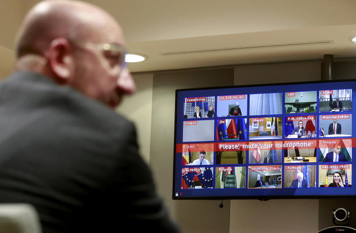 European Council President Charles Michel, left, participates in a videoconference call with EU leaders at the European Council building in Brussels, Tuesday, March 10, 2020. EU leaders held a videoconference Tuesday to coordinate efforts across the 27-nation bloc in the hopes of slowing down the spread of the coronavirus. For most people, the new coronavirus causes only mild or moderate symptoms, such as fever and cough. For some, especially older adults and people with existing health problems, it can cause more severe illness, including pneumonia. (Stephanie Lecocq, Pool Photo via AP)