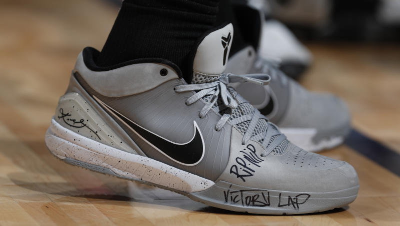San Antonio Spurs guard DeMar DeRozan (10) wears Nike Kobe Bryant shoes bearing a tribute to slain rapper Nipsey Hussle in the second half of an NBA basketball game Wednesday, April 3, 2019, in Denver. The Nuggets won 113-85. (AP Photo/David Zalubowski)