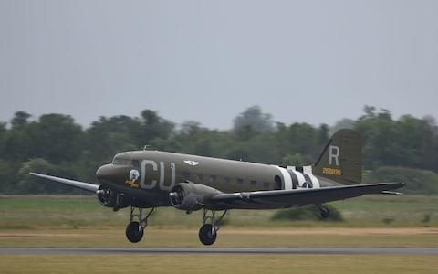 A Douglas C-53 named D-Day Doll takes off from the runway at the Imperial War Museum Duxford - Credit: Joe Giddens/PA