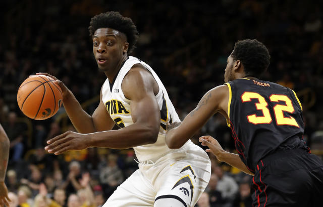 "Iowa forward <a class=""link rapid-noclick-resp"" href=""/ncaaf/players/245130/"" data-ylk=""slk:Tyler Cook"">Tyler Cook</a> delivered a crushing blow to PSU defender <a class=""link rapid-noclick-resp"" href=""/ncaab/players/126284/"" data-ylk=""slk:Shep Garner"">Shep Garner</a>. (AP file photo)"