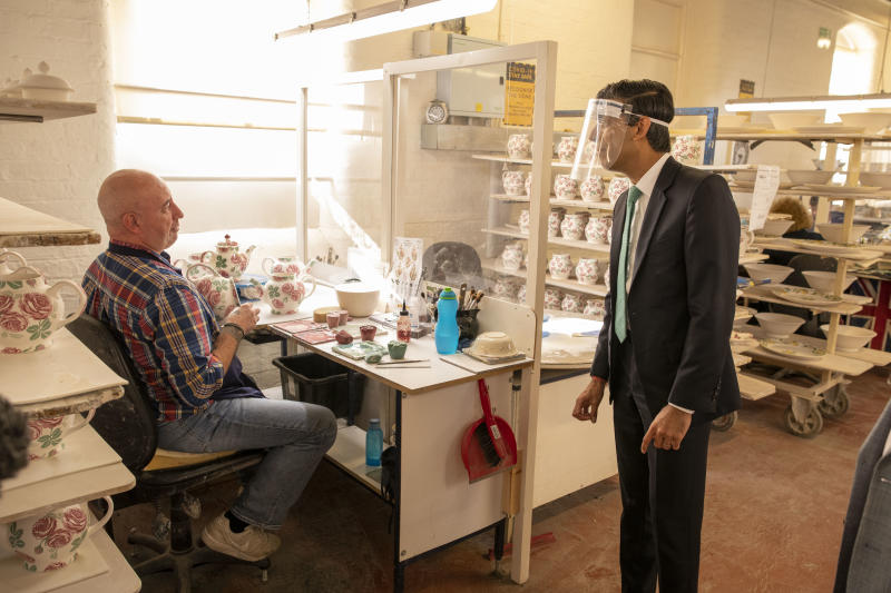 STOKE-ON-TRENT, ENGLAND - SEPTEMBER 14: Chancellor Rishi Sunak chats to Colin Colcloughl during a visit to the Emma Bridgewater pottery after employees returned back to work after being furloughed on September 14, 2020 in Stoke-on-Trent, England. (Photo by Andrew Fox - WPA Pool / Getty Images)