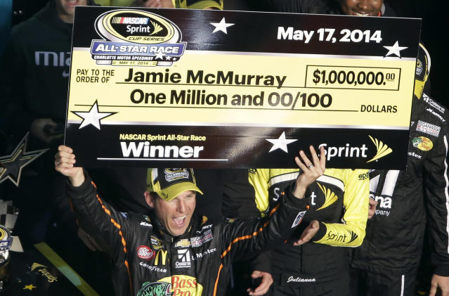 Jamie McMurray celebrates after winning the NASCAR Sprint All-Star auto race at Charlotte Motor Speedway in Concord, N.C., Saturday, May 17, 2014. (AP Photo/Gerry Broome)