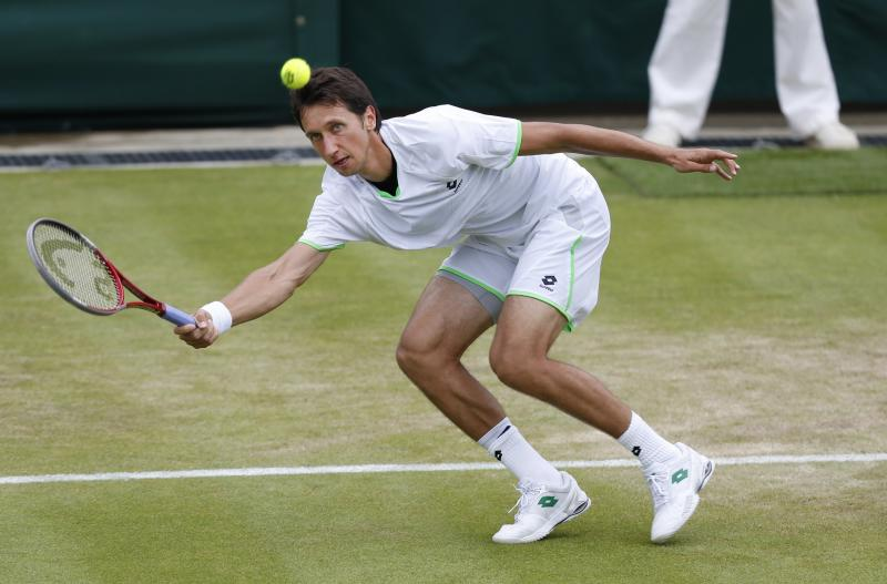 Sergiy Stakhovsky of Ukraine plays a return to Jurgen Melzer of Austria during their Men's second round singles match at the All England Lawn Tennis Championships in Wimbledon, London, Friday, June 28, 2013. (AP Photo/Sang Tan)