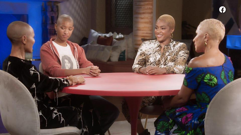 From left: Jada Pinkett Smith, Willow Smith, Tiffany Haddish, and Adrienne Banfield Norris sitting at a red table.