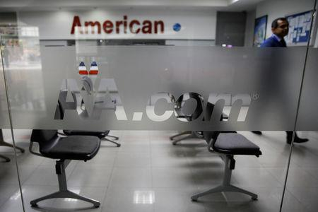 Corporate logos of American Airlines are seen at their office in Caracas, Venezuela March 15, 2019. REUTERS/Carlos Garcia Rawlins