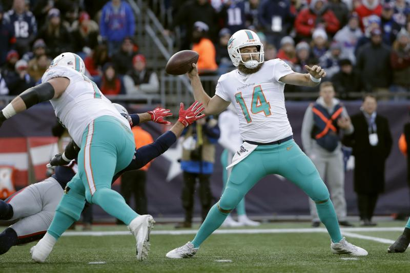 Miami Dolphins quarterback Ryan Fitzpatrick passes under pressure in the first half of an NFL football game against the New England Patriots, Sunday, Dec. 29, 2019, in Foxborough, Mass. (AP Photo/Elise Amendola)