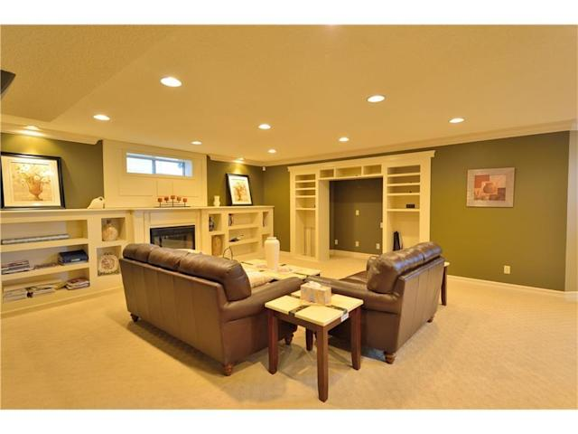<p><span>4686 Hamptons Way Northwest, Calgary, Alta.</span><br>In the basement, you'll find one of the bedrooms and one of the bathrooms, plus this recreation room with fireplace.<br>(Photo: Zoocasa) </p>