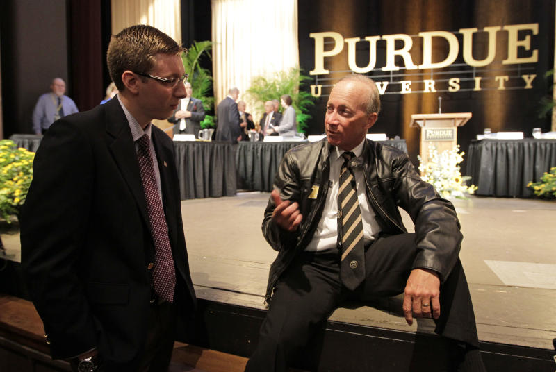 Indiana Gov. Mitch Daniels speaks to a student after being named as the next president of Purdue University by the school's  trustees in West Lafayette, Ind., Thursday, June 21, 2012. Daniels will take the helm of the school after leaving office in January and succeeds France Cordova who will leave in July after five years at Purdue's helm. (AP Photo/Michael Conroy)