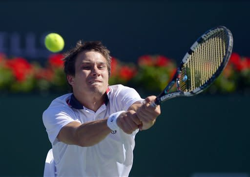 Evgeny Donskoy, of Russia, returns a shot to Andy Murray, of Great Britain, during their match at the BNP Paribas Open tennis tournament, Sunday, March 10, 2013, in Indian Wells, Calif. (AP Photo/Mark J. Terrill)