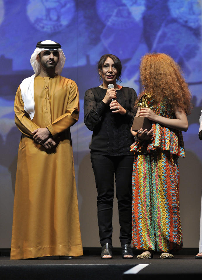 DUBAI, UNITED ARAB EMIRATES - DECEMBER 16:  (L-R) HH Sheikh Mansoor bin Mohammed bin Rashid Al Maktoum, Director Haifaa Al Mansour and actress Waad Mohammed on stage during the Closing Ceremony on day eight of the 9th Annual Dubai International Film Festival held at the Madinat Jumeriah Complex on December 16, 2012 in Dubai, United Arab Emirates.  (Photo by Gareth Cattermole/Getty Images for DIFF)