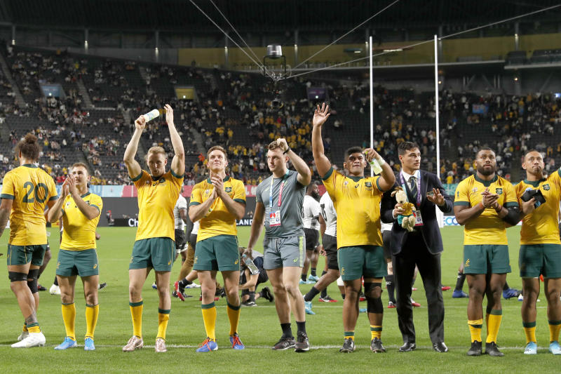 Australia's rugby team waves to the crowd after their 39-21 win over Fiji during the Rugby World Cup Pool D game at Sapporo Dome between Australia and Fiji in Sapporo, Japan, Saturday, Sept. 21, 2019. (Juntaro Yokoyama/Kyodo News via AP)
