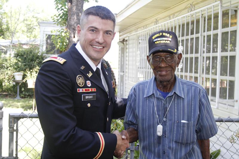 107-year-old Richard Overton, right, the oldest recorded living US veteran, visits with fellow veteran and Philips representative Chris Bright after being presented with the Philips Lifeline with AutoAlert service at Overton's house on Wednesday, June 5, 2013 in Austin, Texas. The medical alert service, which will help protect Overton as he continues to remain independent in his home, was provided free of charge for the rest his life in appreciation for his courageous service to our country. Overton served for the Army in the Pacific during World War II.(Jack Plunkett / AP Images for Philips Lifeline)